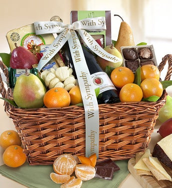 With Sympathy  Love Gourmet Fruit Gift Basket