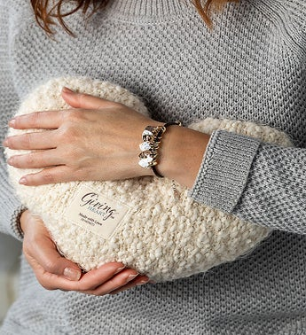 The Giving Heart Pillow and Charm Bracelet
